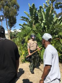 Police with baton in hand in anticipation for an attack in El Cajon | The Black Lion