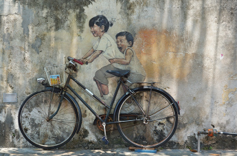 penang-street-art-8-kids-on-bicycle | malaysia-penang-street-art-and-photography-by-lynn-b-walsh | BL | Black Lion Journal | Black Lion